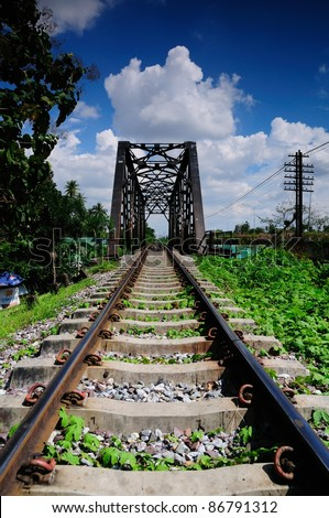 Railway bridge and track at Bangkoknoi, Talingchan, Thailand. It is near Talingchan floating market. - stock photo