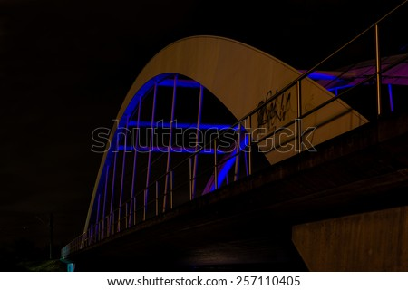 Railway bridge at night in Ostfildern, Germany - stock photo