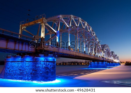 Railway bridge at night in winter - stock photo