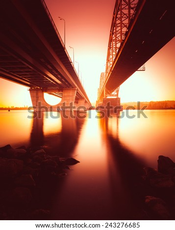 Railway Bridge in Kiev at sunset. Ukraine.  - stock photo