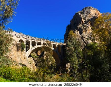 Railway bridge in  mountains near Caminito del Rey. Andalusia, Spain - stock photo