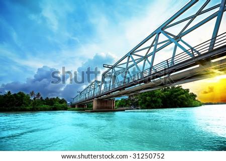 Railway bridge over the river at sunset time. Vietnam. Nha Trang - stock photo