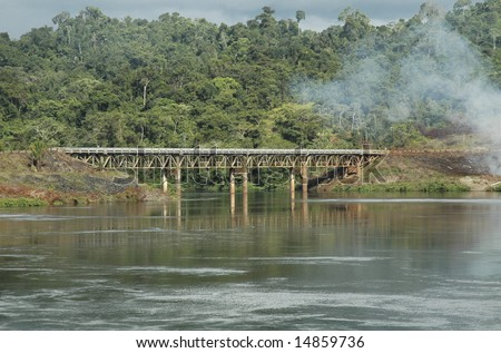 Railway bridge over the water near the power station in Brokopondo, Suriname