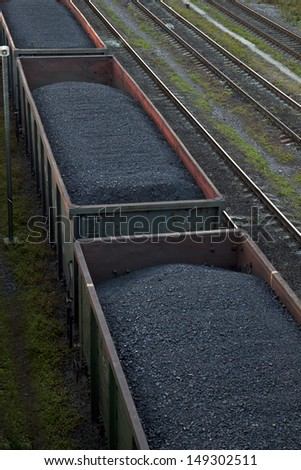 Railway cargo cars carrying coal - stock photo