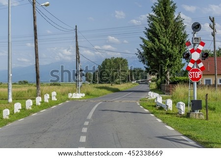 Railway crossing on a country road - stock photo