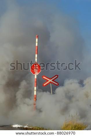 railway crossing smoke barrier danger - stock photo