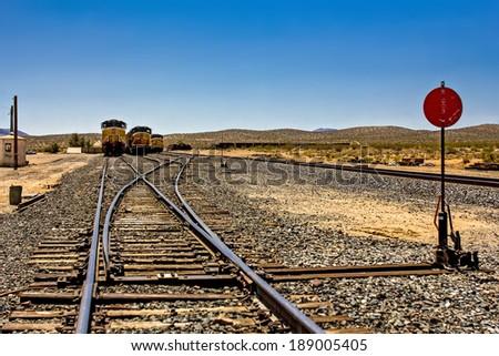 railway crossroads with diesel locomotives - stock photo