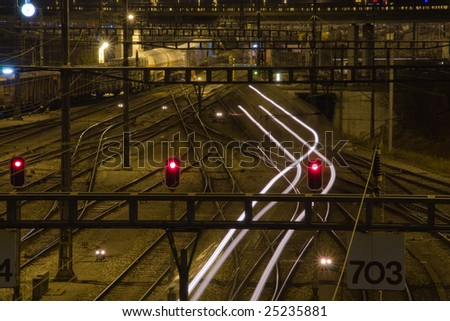 railway humb yard with light signals in the night - stock photo