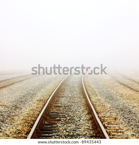 Railway in fog - stock photo