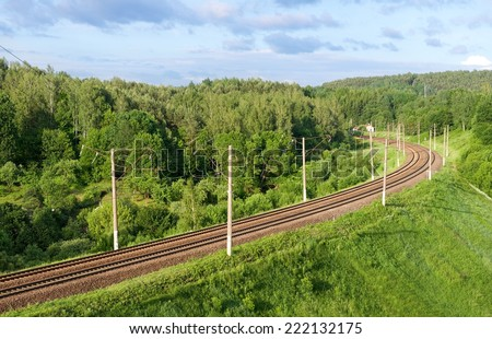 Railway in sunny day, summer time,selective focus, Railway in Lithuania on green summer background, railway in the forest, railway, transportation object,background, road,transport system in Lithuania - stock photo