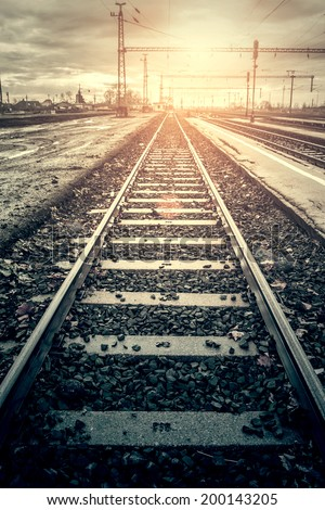 Railway in sunset - stock photo