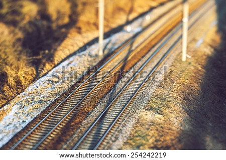 Railway in sunset, winter time, selective focus - stock photo