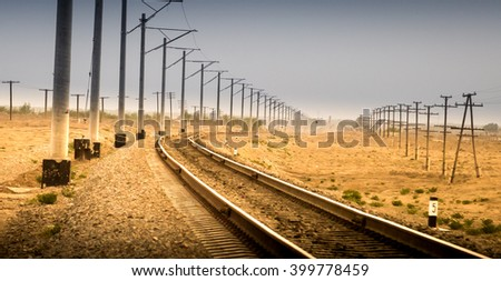 Railway in the desert - stock photo