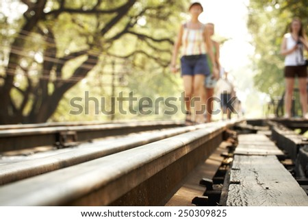 Railway in the park - bleary - stock photo