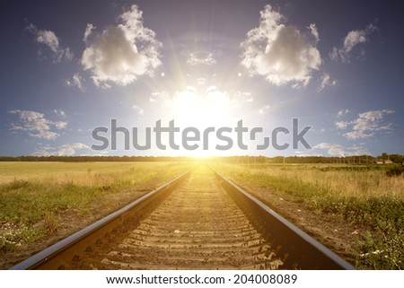 Railway into the sunset  - stock photo