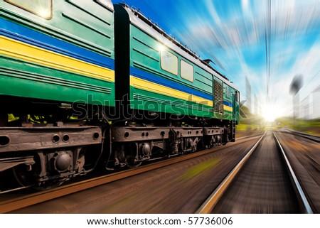 Railway journey towards the sunset - stock photo