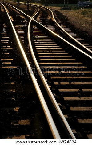 Railway junction glowing in the sunset - stock photo