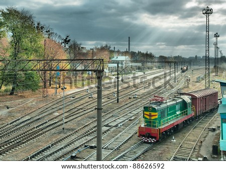 railway junction station at sunset - stock photo
