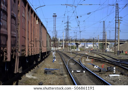 Railway landscape. Many railroad cars and tanks standing in rails