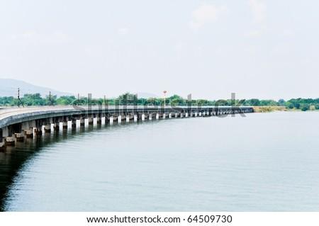 Railway line across the reservoir - stock photo