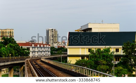 Railway lines/tracks of electric subways surrounded by public housing apartments at sunset in Singapore. Transportation and urban concept. Panoramic style - stock photo