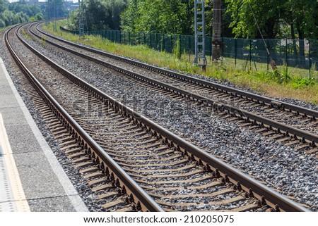 Railway lines travel through a railway station - stock photo