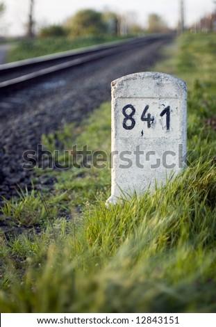 Railway milestone number 841 in the grass - stock photo