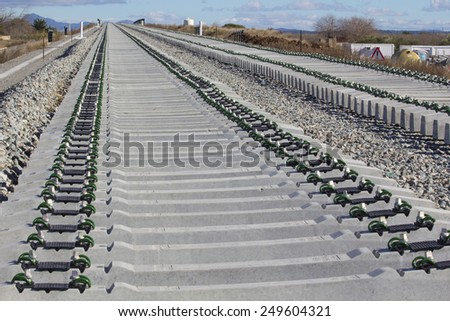 Railway on construction, gravel and railway sleepers - stock photo