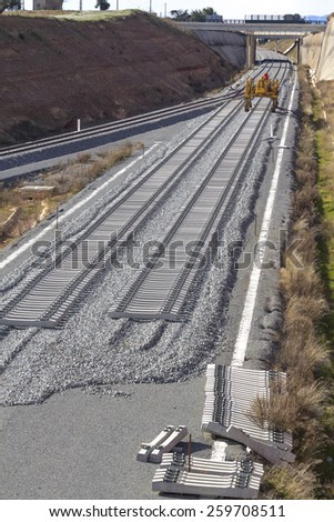 Railway on construction, with specific machine - stock photo