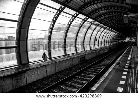 Railway or railroad tracks for train transportation. Black-white photo. - stock photo