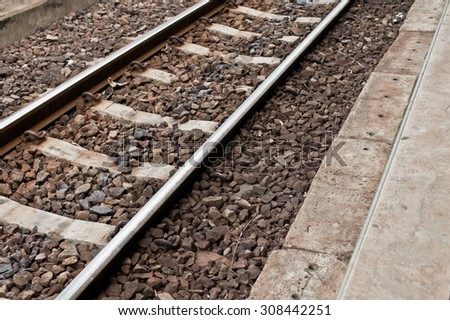 Railway or railroad tracks for train transportation in station.  - stock photo