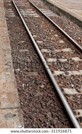 Railway or railroad tracks for train transportation in station.