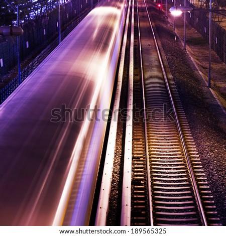 Railway or railroad tracks for train transportation,night  - stock photo
