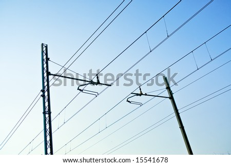 railway pylons of the high tension line - stock photo