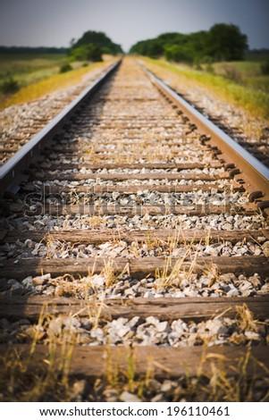 Railway, Railroad, Train Tracks, Green Pasture, Selective Focus - stock photo
