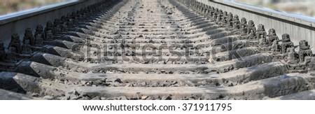 Railway rails and cross ties closeup - stock photo
