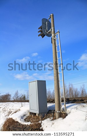 railway semaphore on blue background - stock photo