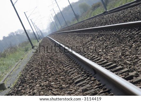 Railway shot with overhear cables and side lights. Tilted perspective - stock photo