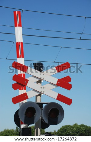 railway sign and traffic lights at a railroad crossing - stock photo