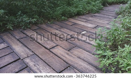 railway sleepers are used as a landscape material on garden footpath it is a matter