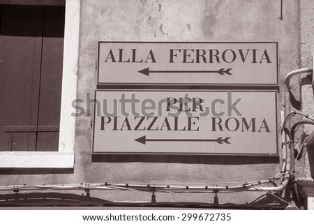 Railway Station and Rome Square Signs, Venice, Italy in Black and White Sepia Tone