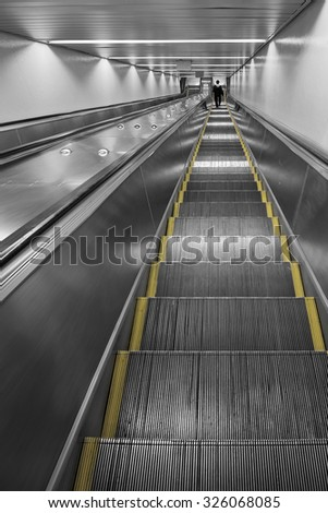 Railway station escalator - stock photo