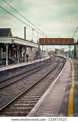 Railway station in the UK in muted tones