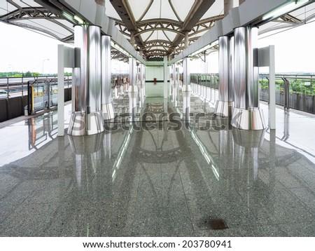 Railway station platforms - stock photo