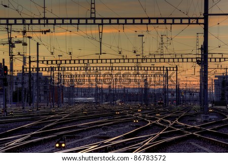 Railway station tracks at dusk