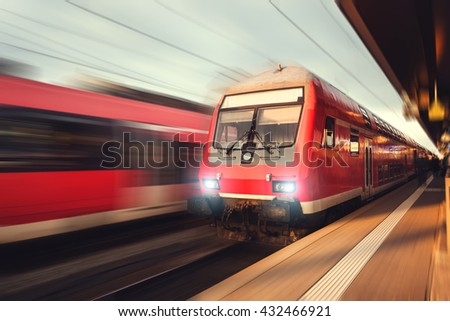 Railway station with modern high-speed  passenger train in motion blur effect Nuremberg, Germany. Railroad - stock photo