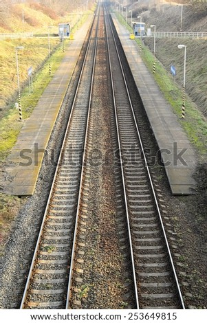 Railway station with platform - train tracks - train Station. - stock photo