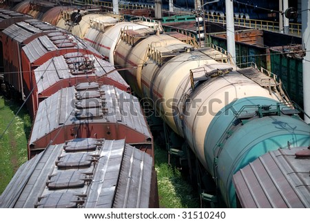 Railway tanks for mineral oil and other cargoes at station - stock photo