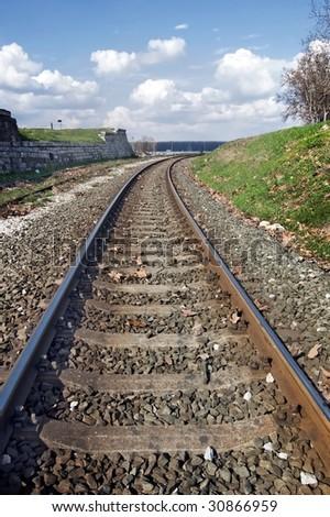 Railway that leads to faraway horizon. - stock photo
