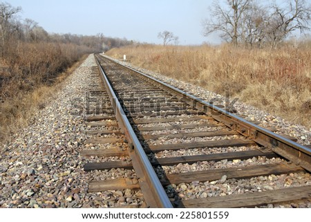 Railway to horizon and clouds on the sky background. - stock photo